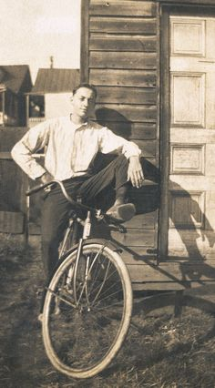 Jacob Mansberger rode his bike from Pennsylvania to Florida in 1927. In the evening, he stopped at farmhouses offering work in exchange for food and a place to sleep. He built the shack you see him leaning on upon his arrival. After a year or so he gave his bike and make-shift cabin to a homeless man and headed home to Pennsylvania with his working crew.....great story, nice adventure.