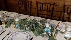 with seeded eucalyptus and baby's breath for farm style table.  3' long.