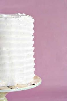 frosting tips and tricks: draw out a design on the edge of a heavy card stock and comb the paper around the edge of the cake.