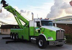 That's one big and mean green tow truck. Who needs a tow truck?