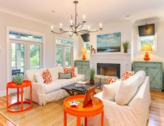 We love this bright white living room with turquoise and orange accents by 'House of Turquoise.'