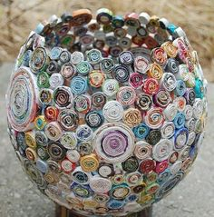 Strips of magazine paper coiled and glued to a balloon. Pop the balloon when glue dries. Use it as a container for lightweight things or create a funky lamp out of it.