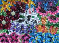 Cat in the Garden - Wall art made for my niece with beads and buttons.