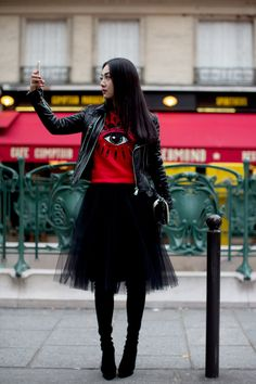 At Kenzo, Paris--black tulle skirt, black boots & biker jacket with a graphic tee.