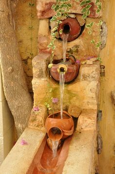 Pretty cool little garden fountain. It would fit in so naturally in a southwestern/adobe home.