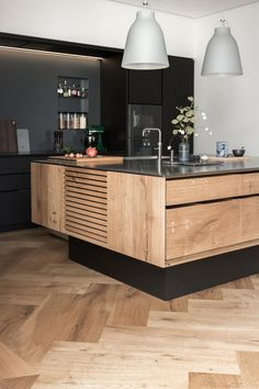 Dinesen handmade kitchen and GrandPattern herringbone flooring