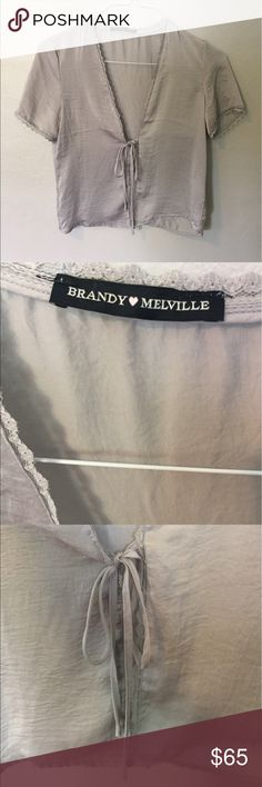 Satin Brandy Melville Leesa Silky Top ✨ NWOT Literally NWOT. Never ever worn. // Brandy Melville one size fits all, so I would guess sizes 00-6 🤷‍♀️ Satin, sexy, in perfect condition. Very 90s meets modern. Love love love this top I just haven't had a chance to wear it and it makes me sad hanging in my closet without any love // you need this piece! // RARE, not made anymore by Brandy Melville ✨✨✨ Brandy Melville Tops