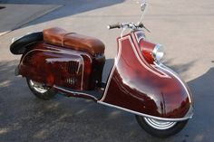 """IWL Pitty, one of the rarer German scooters, had a 123 cc engine with a 3 speed floor shift transmission. IWL was based in the southern suburbs of Berlin, the Russian sector and had four models. First, the Pitty which was built in 1955 and 1956. In 1956, it was replaced by a redesigned scooter, the Wiesel SR 56 which was replaced in 1959 by the Berlin Roller SR 59, the best selling of the IWL scooters. The unfortunately named """"Troll"""" was the last of the IWL scooters."""