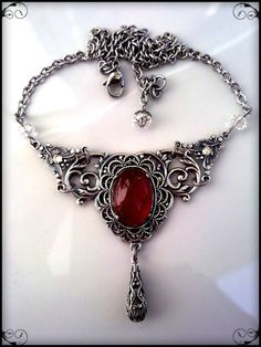 Victorian Gothic Necklace  ♥♥♥♥♥♥♥  Another example of the same red matte stone against the silver setting.  Beautiful
