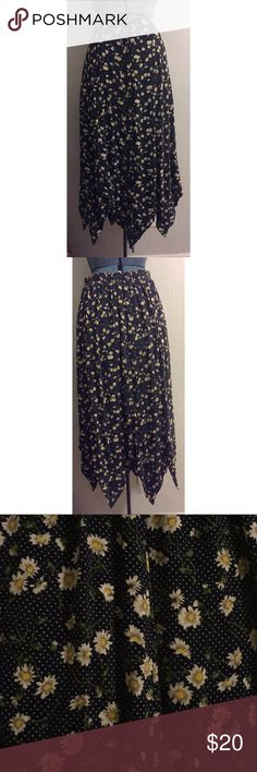 """Vintage 90s Flower Skirt- Grunge Vintage 90s Polka dot Flower Skirt- Grunge. Great condition vintage piece. Can be worn high waisted or on the hips so it can fit many sizes. I measured the hips 8"""" below the waist. The bottom of the skirt is the best part: check pictures to see the fun diamond hem. Waist 14"""" Hips 22.5"""" Length 35"""" vintage Skirts Maxi"""