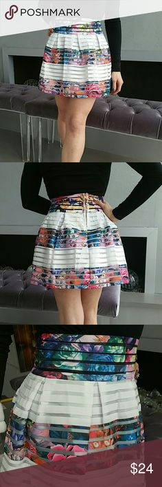 """GORGEOUS FLORAL PRINT SKIRT BRAND NEW WITH TAG  Gorgeous floral print with white stripes skirt. Rows of floral elastic, white elastic and clear fabric make this skirt a true statement maker.  White lining Size small Total length approximately 15.5"""" zip up in back  Material 80% polyester 20% elastic (skirt is semi stretchy) Size small  *Juniors/ petite fit in my opinion*  *AVAILABLE IN SMALL or LARGE* Skirts"""