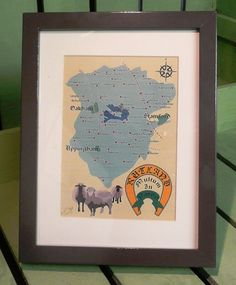 "Designed by local artist, this lovely frame shows a map of the smallest county in Britain and the County motto ""Multum in Parvo"" meaning much in little or a great deal in a small space!"