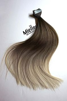 """The LIGHT ASH BROWN BALAYAGE is a blend of grizzly brown roots, willow brown middle and toasted blonde tips. You will look flawless with this amazing color. Product Details: Seamless tape in extensions Pre-taped & ready to use Made of Remy Human Hair Sourced from donors in Russia Featuring a silky straight texture Perfectly healthy with cuticles intact Double drawn for extra fullness Thick from top to bottom NOTES: Each piece is 1.5"""" wide and weighs avg 3g. We suggest 20-40..."""