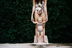 baby and mama pool side for a swim