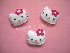 Hello Kitty brooches...make them into barrettes for Anna :)