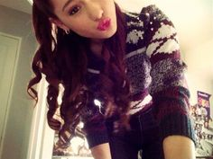 Ariana in her Christmas sweater