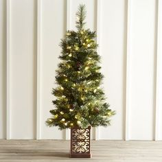 Turn your home into a holiday wonderland with our festive entryway or porch tree, crafted exclusively for Pier 1. Thanks to natural pinecones, continuously lit, single-color LEDs and a beautifully scrolled base, it's a bright way to welcome guests home for the holidays.