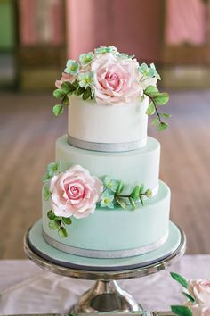 Featured Photographer: Angelworx Angelie Hafzullah Photography; Gorgeous three tier mint green wedding cake with silver wrapped decoration