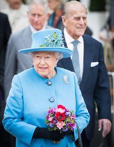 Queen Elizabeth II and Prince Philip, Duke of Edinburgh tour Queen Mother Square on October 27, 2016 in Poundbury, Dorset.