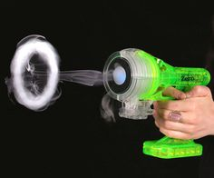 Use your downtime productively at work by creating tiny vapor rings using this vapor blaster gun. The blaster features a vibrant translucent neon green casing and fires off safe/non-toxic water rings up to twelve feet away.