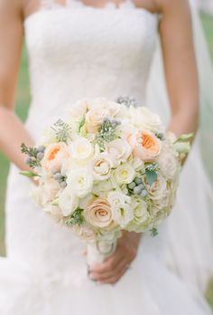 Brides.com: 15 Pretty Peach Bouquets. Bouquet of peach and white roses with berry accents from Bella Fioria Floral Design.