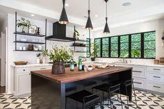 black & white kitchen: black open shelving, hood, windows, lighting, hardware