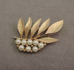 Signed Alan J. Gold Tone and Faux Pearl Leaf Pin 1960s by thejeweledbear on Etsy
