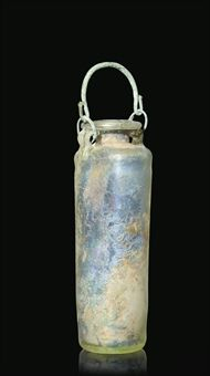 A ROMAN GREEN BLOWN GLASS CYLINDRICAL FLASK WITH BRONZE HANDLE LATE 1ST-2ND CENTURY A.D.