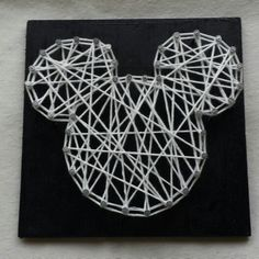 Either stain the wood or cover it with fabric. Then do the string art over the top.