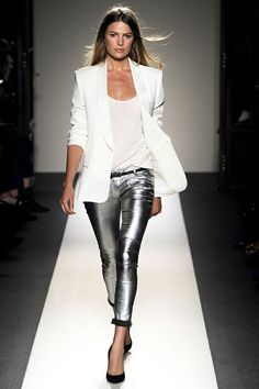 Step up your off-duty look in a white blazer and silver leather slim trousers. For the maximum chicness throw in a pair of black leather pumps. Shop this look on Lookastic: https://lookastic.com/women/looks/blazer-tank-skinny-pants/6153 — White Blazer — White Tank — Black Leather Belt — Silver Leather Skinny Pants — Black Leather Pumps