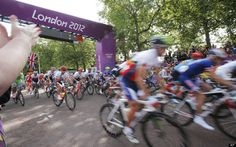 Competitors take the start during the Men's Road Cycling race at the 2012 Summer Olympics, Saturday, July 28, 2012, in London.