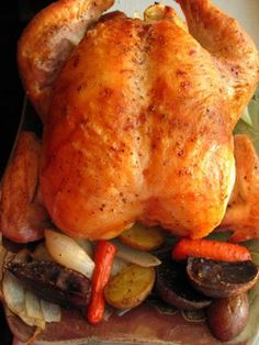 After seeing this on Food Network and trying it that very night, Ill never make a roasted chicken any other way.  The vegetables alone are worth it, but the chicken is so unbelievably tender and juicy that you cant help but go back for seconds.  Ive made only very subtle changes to suit my taste, and I would recommend nearly doubling the veggies if feeding four grown people.  Reheated leftovers are phenomenal (use medium power on microwave).