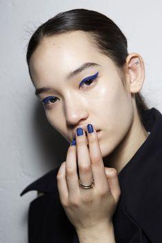 blue eyeliner and nails