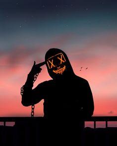A silhouette of a person wearing a LED purge mask. Batman Joker Wallpaper, Joker Iphone Wallpaper, Flash Wallpaper, Smoke Wallpaper, Hacker Wallpaper, Pop Art Wallpaper, Halloween Wallpaper Iphone, Joker Wallpapers, Gaming Wallpapers