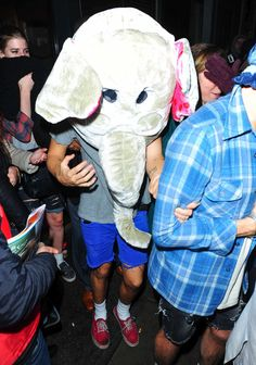 Harry Styles seen leaving Groucho Club after a night out in London, UK on November 30, 2013. Harry was seen wearing a comical elephant head costume as they left the club (FameFlyNet)