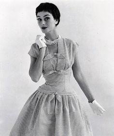Anne GunningAnne Gunning modeling a dress made of Sekers fabric, 1955
