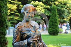Photo about Living statue - Ruth Handler at international festival of living statues in Bucharest, Romania. Image of costume, figure, expression - 93867685 Living Statue, Bucharest Romania, International Festival, Statues, Buddha, Batman, Entertainment, Costumes, Superhero