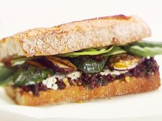 Grilled Vegetable, Herb and Goat Cheese Sandwiches from FoodNetwork.com  When I made these we added grilled mushrooms, raw red onions, goat cheese on both sides of bread and put in panini grill. Very good