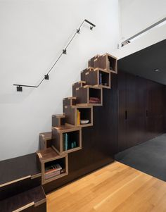 Staggered wooden stairs also double as convenient shelving thanks to their cubby-like form.