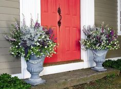 container gardening picture of two formal container gardens flanking a red door