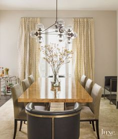 Contemporary Beige Dining Room with Bubble Chandelier