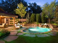 Nestled into an intimate oasis of specimen plants and trees and lawn, this combination spa and plunge pool is bordered by natural stone from Pennsylvania in a design by Pool Environments.