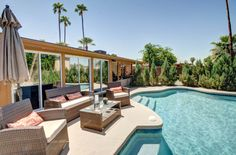 Invite friends over and enjoy the backyard paradise! It has a covered patio, sparkling pool, above ground spa, fresh air patios, outdoor shower, synthetic grass, a dog run and a gated side storage with concrete pad.