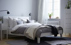 NORDLI bed with bedside table and SVEIO chest of drawers all in white (but I'd put in the natural-colored bed)