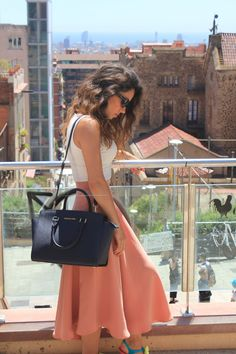 Michael Kors dark blue bag with salmon skirt