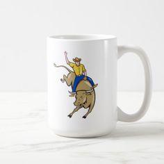Rodeo Cowboy Bull Riding Cartoon Coffee Mug. Coffee mug showing an illustration of rodeo cowboy riding bucking bull on isolated white background done in cartoon style. #cowboy #rodeo #coffeemug