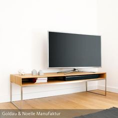 Für Puristen mit Anspruch! TV-Lowboard JANO ist ein minimalistisch designtes Sideboard aus Massivholz mit filigranem Gestell aus Edelstahl.  #tv #lowboard #pur #minimalistisch #holz #skandinavisch #design #interior Hifi Regal, Regal Design, Office Desk, My House, Scandinavian, Loft, Couch, Living Room, Janus