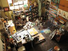 someday. someday i will have a crazy, cluttered, beautiful space like this in which to create my art!