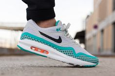 "Have a look at the counterpart of Nike's recently released ""Hot Lava"" colorway of its Air Max Lunar1 Breeze sneaker. The sneaker's lightweight and breathable mesh body sports a calm, cool grey half th..."