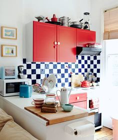 Sneak Peek: Best of Red! This London kitchen demonstrates how just a little bit of red paint can make a large visual impact. (Isn't that cutting board genius?) #sneakpeek